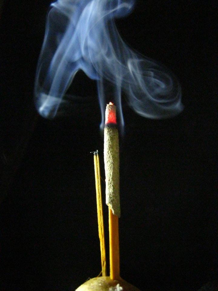 Lighted incense stick